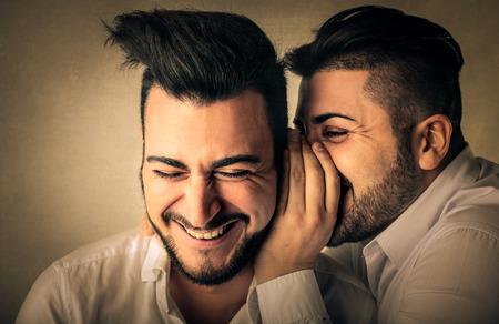 mates: Mates whispering secrets Stock Photo