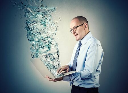 glass water: Man using a special laptop