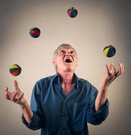 juggling: Man juggling with balls