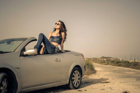 women in jeans: Woman travelling by car