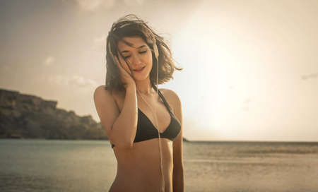 narcissism: Woman at the beach Stock Photo