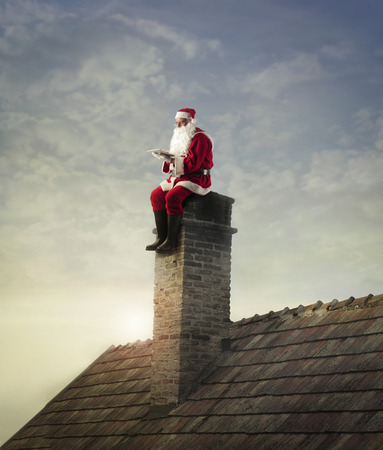 outdoor fireplace: Santa sitting on the chimney