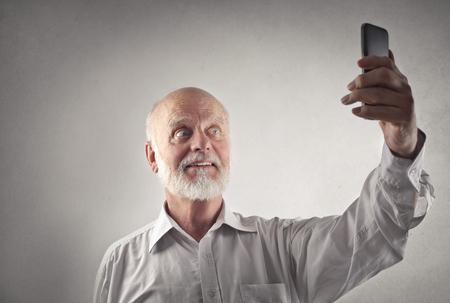 old man beard: Man doing a selfie