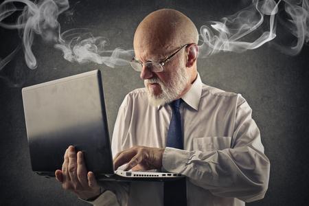 man with laptop: Furious businessman