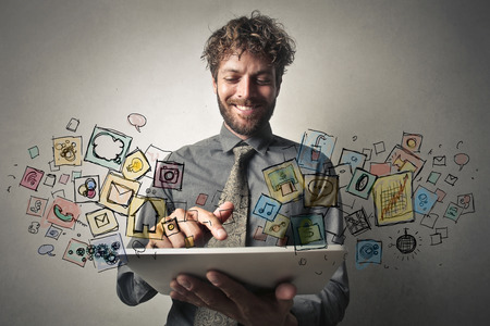 application icons: Man using apps on a tablet