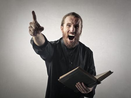 Priest doing a sermon Stock Photo