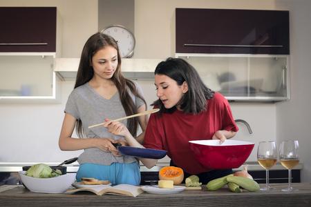 tastes: Girls cooking in the kitchen