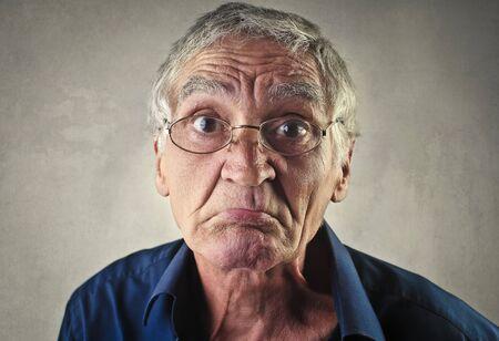 disdain: Surprised man