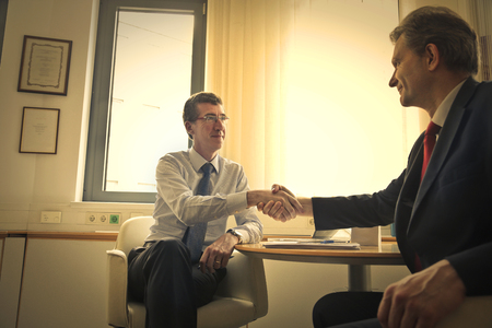 deal making: Two businessmen making a deal Stock Photo