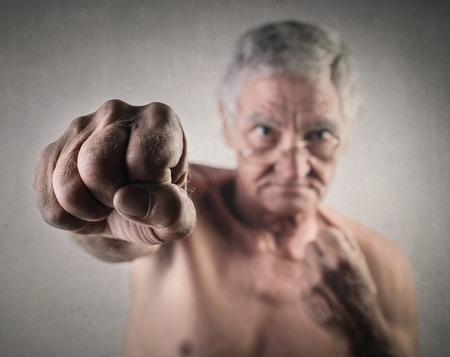 beat: Elderly man throwing a fist Stock Photo