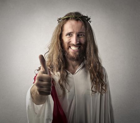 イエス ・ キリストのための親指 写真素材
