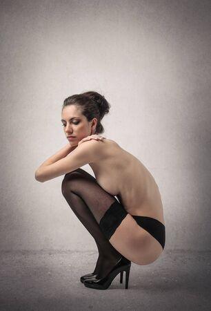 Model wearing black stockings