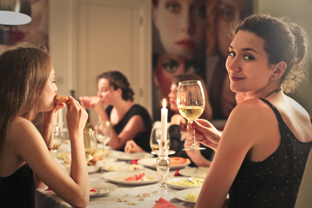 people eating restaurant: Woman at an elegant dinner Stock Photo
