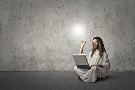 ironic: Jesus using a laptop Stock Photo