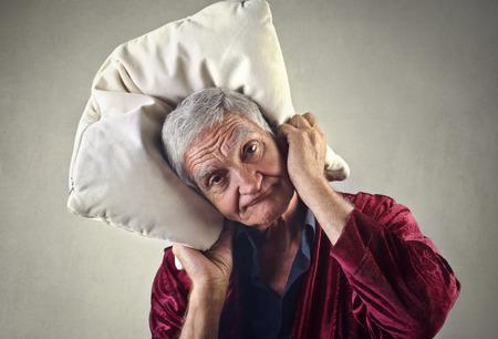 sleepy man: Sleepy man holding a pillow