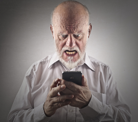 Angry man trying to use a smart phone