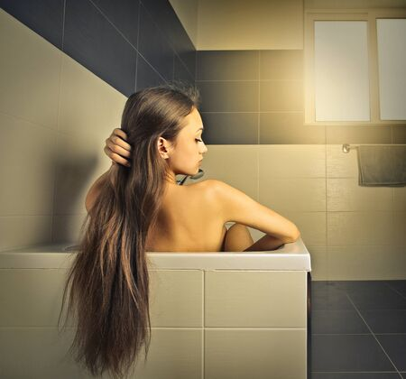 woman in bath: Long-haired woman in the bath tube