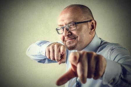 exult: Pointing businessman