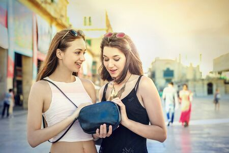 looking into: Looking into a black purse