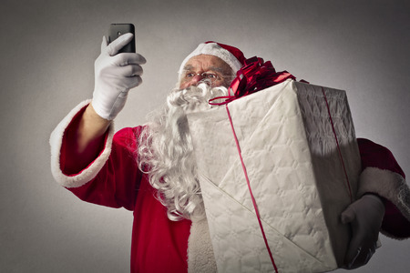 claus: Santa Claus with a big gift