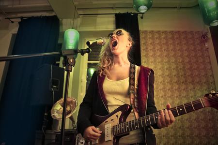 bass guitar women: Singer and guitar player Stock Photo