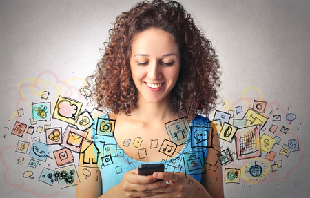 using phone: Girl using phone apps Stock Photo