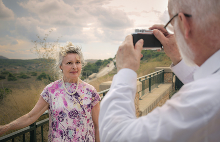 taking a wife: Man taking a picture of his wife Stock Photo