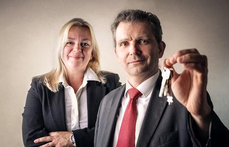 professionalism: Businessmen holding keys