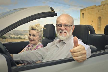 old car: Self-confident elderly man driving a car