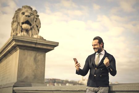jubilate: Successful manager celebrating Stock Photo