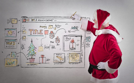 page site: Santa Claus drawing a web site page Stock Photo