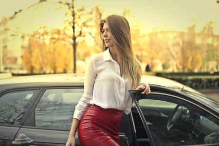 autumn colors: Beautiful woman next to her car Stock Photo