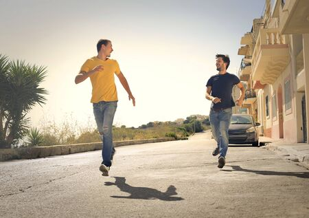 two men: Two men running Stock Photo