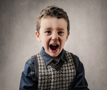 tantrums: Shouting young boy