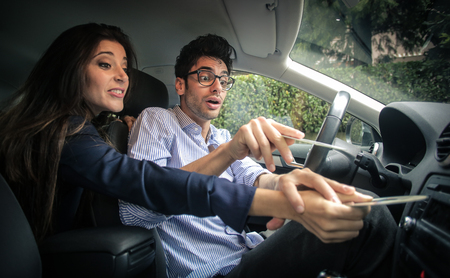 argues: Couple arguing for a cd in the car Stock Photo