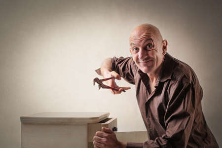 furniture: Man fixing furniture