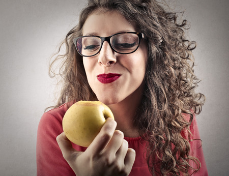 girls youth: Eating an apple Stock Photo