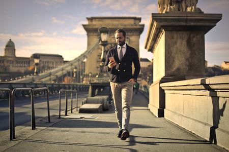 atmospheres: Man walking on a bridge