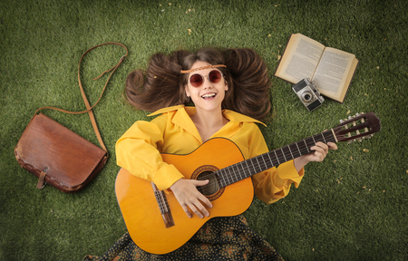 woman guitar: Happy girl playing the guitar Stock Photo