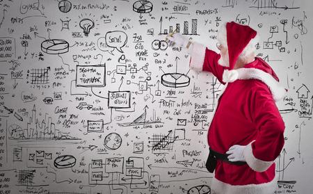 confundido: Santa Claus dibujar gráficos de negocios