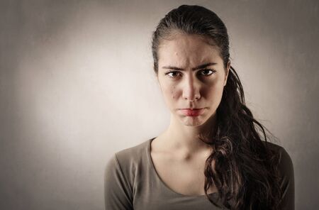pimples: Disappointed womans portrait Stock Photo