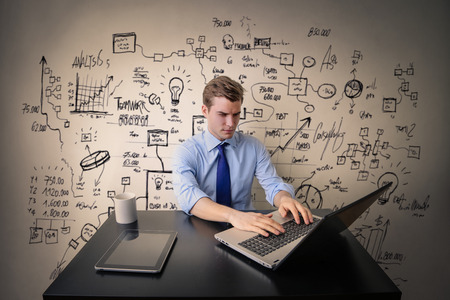 decipher: Young businessman working long shifts