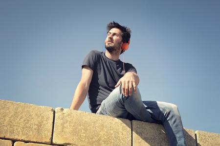 beautiful boys: Man sitting in the sunshine
