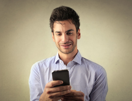 see: Self-confident man using a smartphone