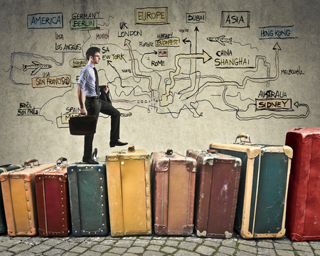 invest: Travelling businessman walking on a pile of suitcases