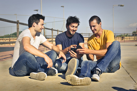speak: Three men sitting on the ground
