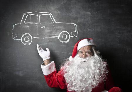 drives: Santa Claus thinking of a car