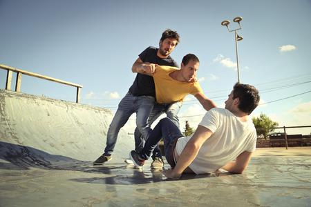 Three men in a fight Stock Photo