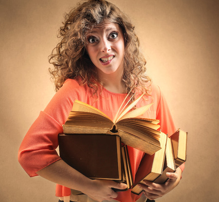 gnaw: Woman carrying different books Stock Photo