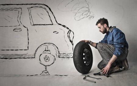 tire change: Mechanic changing a wheel Stock Photo